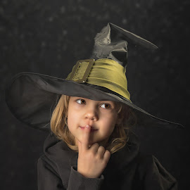 Cute little witch by Mario Toth - Babies & Children Child Portraits ( studio, expression, person, holding, little, caucasian, hat, halloween, kid, hand, child, girl, happy, witch, dark, childhood, celebrate, black, isolated, fun, young, portrait, human, holiday, magic, female, dress, background, costume, small )