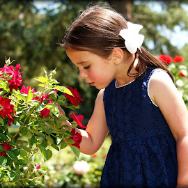 Pretty Flowers by Becki Barnard O'Connor - Babies & Children Child Portraits ( child, girl, smelling, outdoor, flowers, garden, pretty )