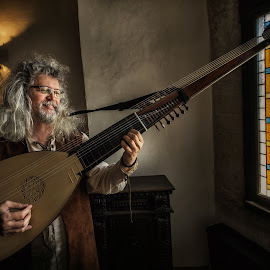 Medieval singer by Grigore Roibu - People Musicians & Entertainers ( music, window, indoor, performance, art, guitar, musician, castle, medieval, portrait )