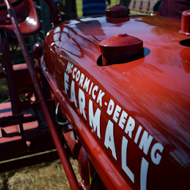 Tractor by Andrew Jensz - Transportation Other ( farm machinery, red, restored, close up, tractor )