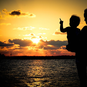 Pointing to the Heavens by Victoria Evans - Landscapes Sunsets & Sunrises ( sunset, silhouette, louisiana, children, gulf of mexico,  )