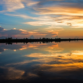 Cajun Fire by Wendy  Walters - Landscapes Waterscapes ( gulf coast, louisiana, suns afterglow, marsh, cloud reflections, the golden hour, mississippi )