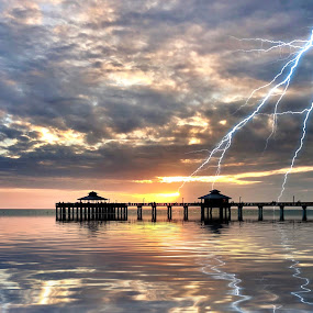 Stormy Sunset by Lorna Littrell - Landscapes Weather ( lightening, pier, storm, stormy, waterscape, reflections, sunset )