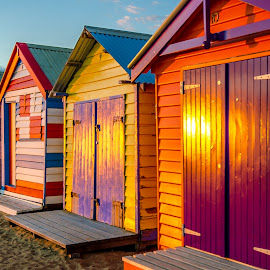 Bathing Huts by Peter Liakopoulos - Buildings & Architecture Other Exteriors ( bathing hut, colorful, sunset, seaside, beach, sunlight )