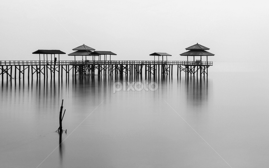 calm and cozy by Rio Tanusudiro - Landscapes Waterscapes ( water, mono-tone, building, reflection, b&w, black and white, reflections, black and white collection, beach, architecture, places, monotone, landscape, people, kenjeran, kenji, pier, b and w,  )