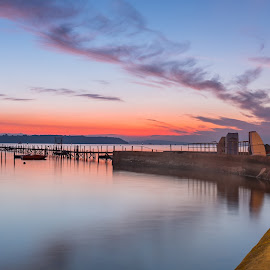 Sunset at Sandbanks. by Roy Hornyak - Landscapes Waterscapes ( lit, clouds, calm, orange, reflection, calmness, beautiful, harbour, boats, sea, jetty, coastal, fire, coast, island, sky, red, blue, lamp, pier, evening, light, wall, masts )