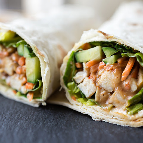 "Thai-Style Peanut Chicken ""Spring Roll"" Wraps with Cool Greens, Cucumber and Carrots, drizzled with a Sweet & Spicy Peanut Sauce"