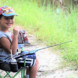 Drink, chips,fishing rod...I'm all set!! by Priscilla Renda McDaniel - Babies & Children Children Candids ( child, chips, happy, drink, fishing, fishing rod )