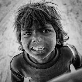 Stare by Vijay Tripathi - Black & White Portraits & People ( girl, black and white, india, street scene, eyes, potraits, street photography )