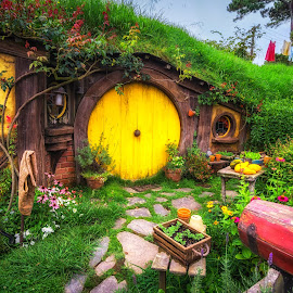 home of Samwise Gamgee by Aaron Choi - Buildings & Architecture Homes ( famous, home, yellow door, waikato, house, travel, beauty, landscape, lord of the rings, photography, samwise gamgee, movie set, fantasy, hobbit hole, nature, lord of the ring, flowers, flower, hobbiton, cobblestone, lotrs, peaceful, pathway, hdr, front yard, movie, tourism, scenic, hobbit, hobbit homes, photo, new zealand, landmark, book, matamata, view, tolkien, garden, north island )