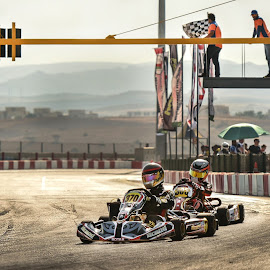 at the Finish Line by D K - Sports & Fitness Motorsports ( speed-way, winning, speed, racing, go_karting, track, fast, motorsport, gears )