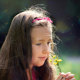 Girl with flower in her hands by Jiri Cetkovsky - Babies & Children Child Portraits ( girl, park, afternoon, flower, portrait )