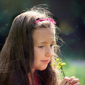 Girl with flower in her hands by Jiri Cetkovsky - Babies & Children Child Portraits ( girl, park, afternoon, flower, portrait )