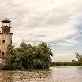 lighthouse by Panait Sorin - Buildings & Architecture Other Exteriors ( sulina, green, lighthouse, water, heaven )