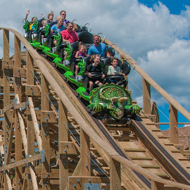airtime on a roller coaster by Michael Graham - City,  Street & Park  Amusement Parks ( wooden roller coaster, story land, amusement park, dinosaur, amusement ride, theme park, roller coaster, new hampshire,  )