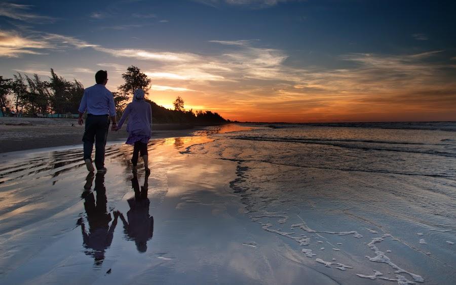 Walk on a Beach by Rashid Mohamad - People Couples ( sunset, wave, yellow, beach, walk )