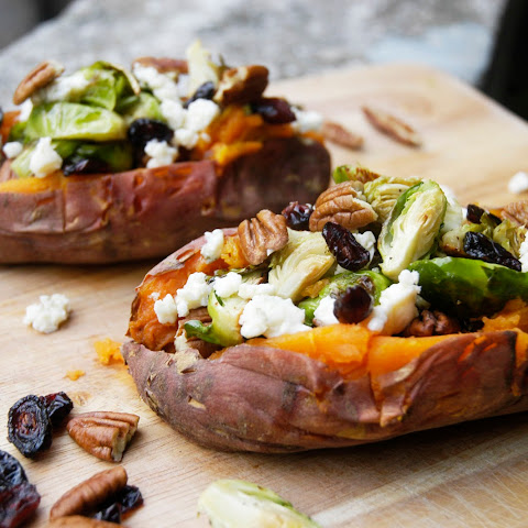 Roasted sweet potato with Brussels sprouts, blue cheese, cranberries and pecans