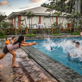 Off you go by Wing Yin Cheong - People Street & Candids ( playing, water, girl, splash, pool, teenagers, power, wet, fun, powerful, women, push )