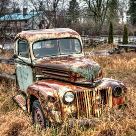 A Million Miles by Ernie Kasper - Transportation Automobiles ( broken, car, old, colourful, window, worn, vehicle, tires, rusted, headlight, classic, weathered )