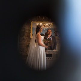Shooting through a peeping hole by Nici Pelser - Wedding Bride