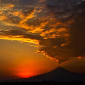 Popocatepetl by Cristobal Garciaferro Rubio - Landscapes Sunsets & Sunrises ( clouds, cholula, mexico, puebla, sunshine, eruption, sun )