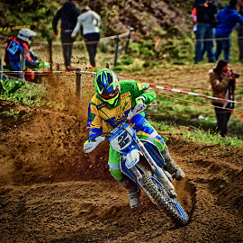 Chasing Number One by Marco Bertamé - Sports & Fitness Motorsports ( curve, 2, two, motocross, green, dust, clumps, number, yellow, race, alone, competition,  )