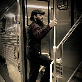 The Businessman  by Brittany Humphrey - People Portraits of Men ( businessman, metra, railroad, train, chicago, portrait, man )