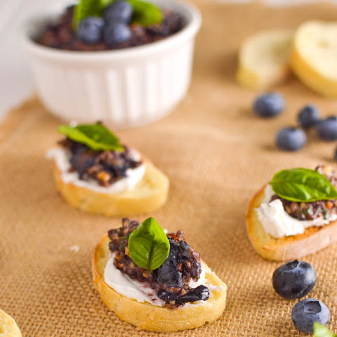 Mashed Blueberry Almond Tapenade and Goat Cheese Crostini