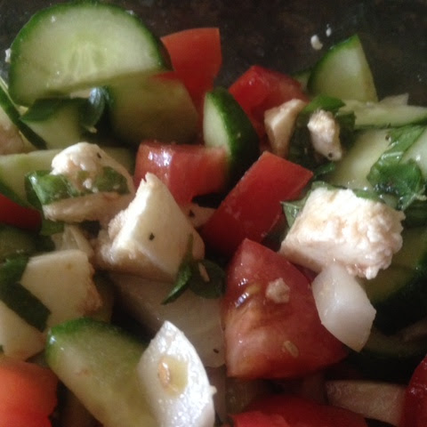 CUCUMBER CAPRESE SALAD * tomato, onion, fresh mozzarella, HERBS * Balsamic dressing *