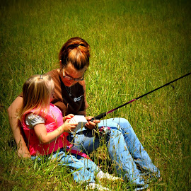 Mother & Daughter by Tammy Price - People Family ( field, grass, daughter, fishing, outside, mom )