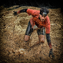Balancing And Fighting Act by Marco Bertamé - Sports & Fitness Other Sports ( water, orange, splatter, splash, differdange, cap, 2015, concentrated, waterdrops, soup, running, luxembourg, balance, mud, strong, drops, dirty, fighting, brown, strongmanrun, man,  )
