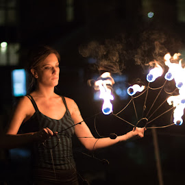 Playing with Fire - 1 by Swin Spivey - People Street & Candids ( lighting, night photography, entertainer, fire, street photography, event photography )