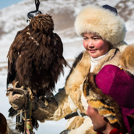 Younger woman hunter with Eagle. by Ulaanaa Mongolia - People Professional People