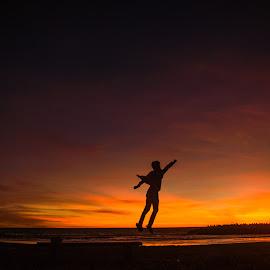 I Believe I Can Fly by Shohibul Huda - Babies & Children Children Candids ( flying, yogyakarta, jumping, levitation, fly, indonesia, sunset, silhouette, nikon, jump )