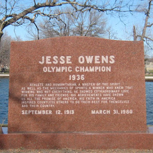 In Oak Woods Cemetery on Chicago's South Side:    Jesse Owens Olympic Champion 1936     Athlete and humanitarian. A master of the spirit as well as the mechanics of sports. A winner who knew that ...