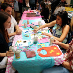 Painting baby clothes during a private Baby Shower