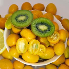 colorful citrus fruits close up by LADOCKi Elvira - Food & Drink Fruits & Vegetables ( citrus, colorful, kiwi, fruits, lemon )