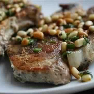 Baked Sea Bass Fillet With Pine Nuts And Olives