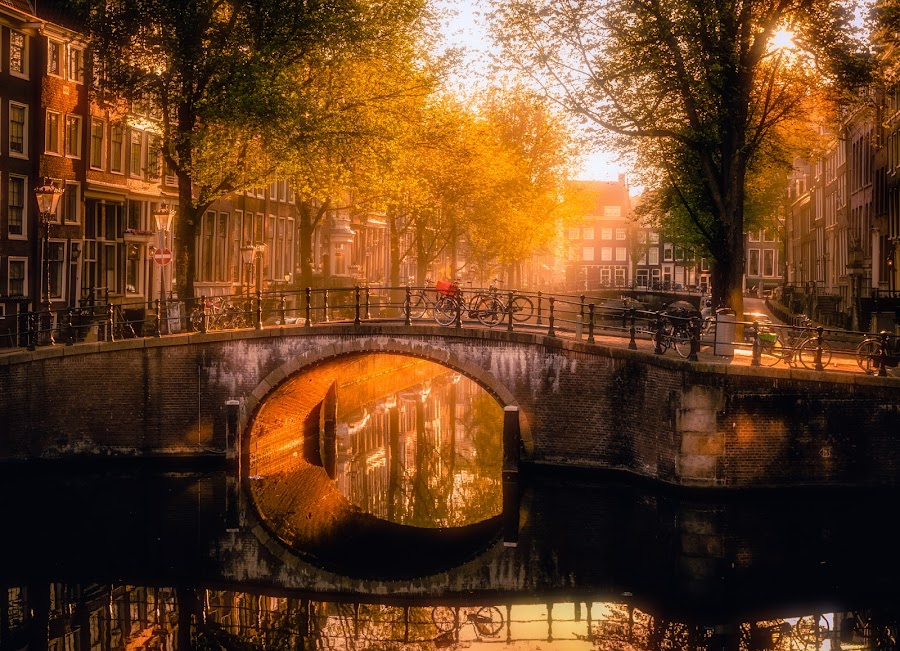 Glowing mornings in Amsterdam by Georgios Kossieris - Buildings & Architecture Bridges & Suspended Structures ( water, building, reflection, holland, trees, amsterdam, bridge, morning, light, netherlands )