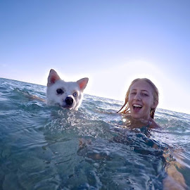 Going for a Swim by Mike Whitehead - Babies & Children Children Candids ( dogs, happy, dogs playing, children candids, ocean, happy dog, swimming,  )