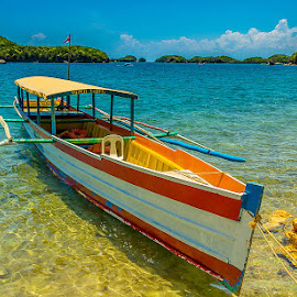 An Outrigger in Alaminos by Anj GoNon - Transportation Boats ( sun and surf, beautiful day, watercraft, outrigger, island hopping, summer fun, transportation, boat, philippines )