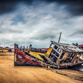 abandon ship near the sea shore by Xicro Kuyon - Transportation Boats ( damaged, shore, old, wood, vehicle, outboard, retro, rusty, beach, transportation, coastline, landscape, forgotten, aged, tranquil, grunge, ancient, weather-beaten, shipwreck, forsaken, motor, ruins, sail, timber, sand, stranded, vintage, engine, obsolete, wreck, traditional, scenic, boat, wooden, outdoors, rusted, scene, scenery, oldtimer, abandon, fisherman, antique, culture, nautical, abandoned )