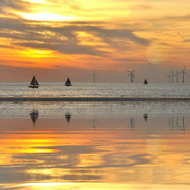 reflections by Susan Davies - Digital Art Places ( tranquil, sunset, calm sea, reflections, silhouettes, wind turbines, yachts )