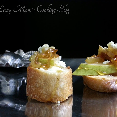 Bruschetta with Brie, Pear, Caramelized Onion, Blue Cheese, and Honey