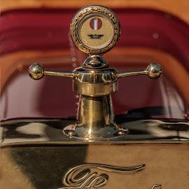 How cars were made. by Eva Krejci - Transportation Automobiles ( car, red, emblem, color, brass )