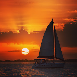 by Lorna Littrell - Transportation Boats ( orange, sailboats, waterscape, sunset, sun )