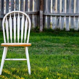 One Lonely Chair by Rob Heber - Artistic Objects Furniture ( natural light, idea, yard, lawn, still life, household object, chair outside, weathered wooden fence, furniture, empty chair, weathered, seat, no people, weathered wood, fence post, backyard, lonely, gowth, golden hour, planks, isolated, grass, empty seat, sunlight, concepts, boards, outside nature, fence, chair, wooden chair, pattern, slats, outdoors, wooden fence, weeds, conceptual, design, green grass )