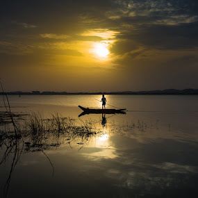 On my way by Karthikeyan Chinnathamby - People Professional People ( clouds, canon, water, reflection, canon5d, waterscape, silhouette, play, chinnathamby, boat, people, sun, chinna, kolavai, karthikeyan, india, fishing, sunrise, fisherman, light, black, man, tamilnadu )