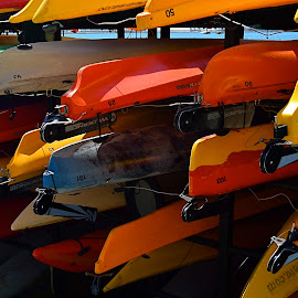 Parked until Summer by Robert Ratcliffe - Sports & Fitness Watersports ( orange, red, colorful, boats, summer, yellow, kayak,  )