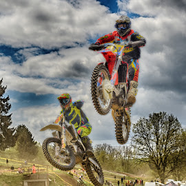 by Marco Bertamé - Sports & Fitness Motorsports ( 261, speed, number, yellow, race, jump, noise, two, flying, red, motocross, blue, 401, hifh, duel )